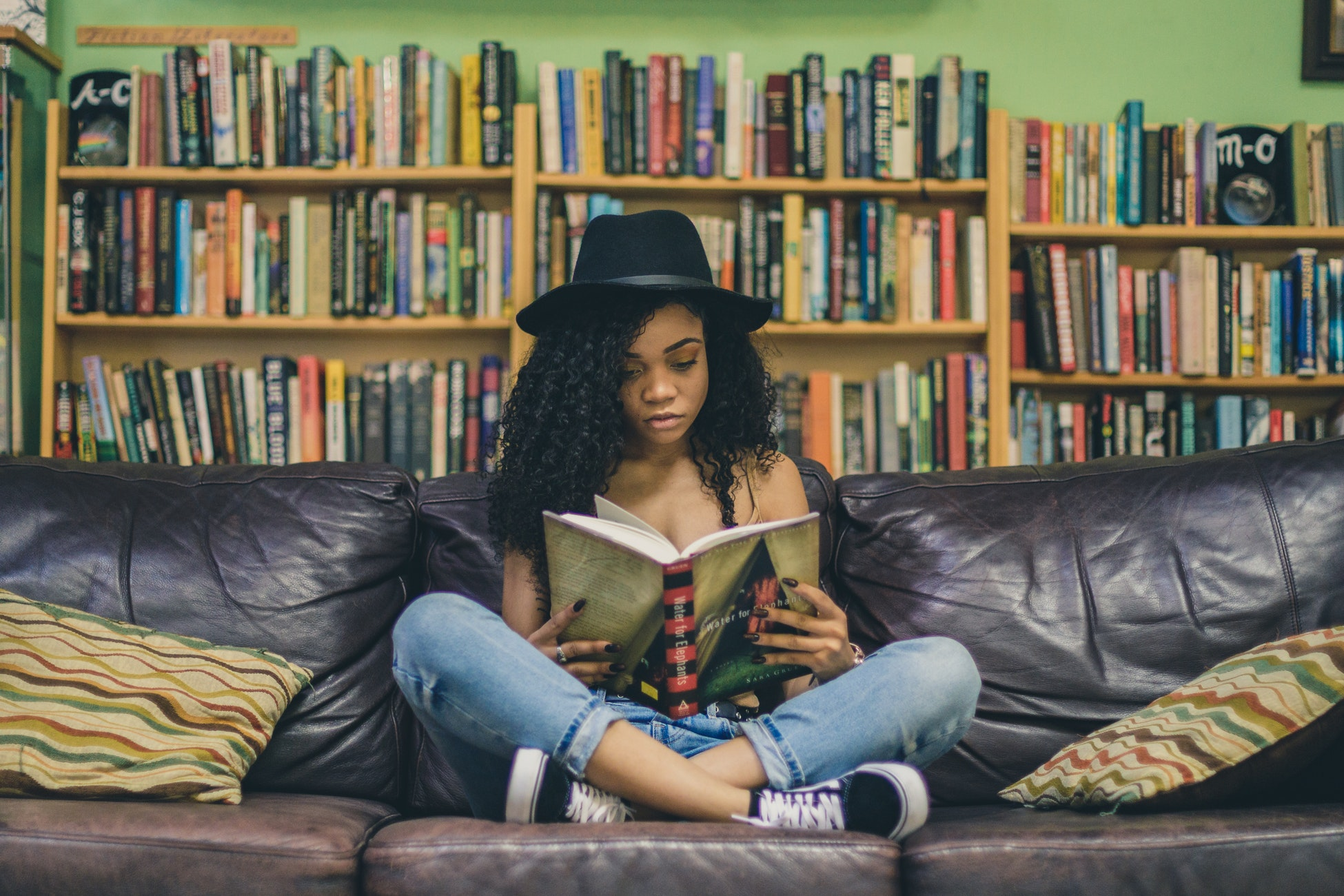 5 Books that Change Your Perspective on Life - Girl Reading in a Library