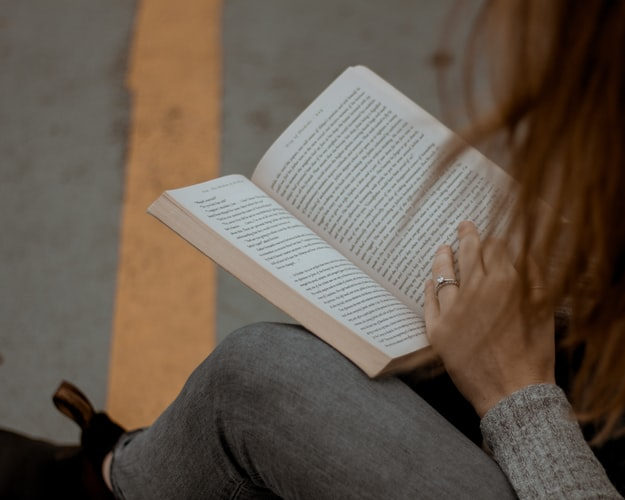 Girl Reading Book: 5 Must-Read Fiction Series
